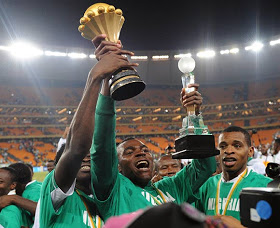 Man of the tournament, Emenike flaunts his personal award and the AFCON trophy