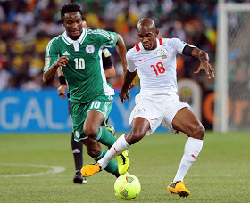 Mikel tackles Kabore of B/Faso