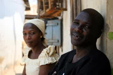 Kate and Emmanuel Musa find they enjoy each other's company. The two are HIV positive